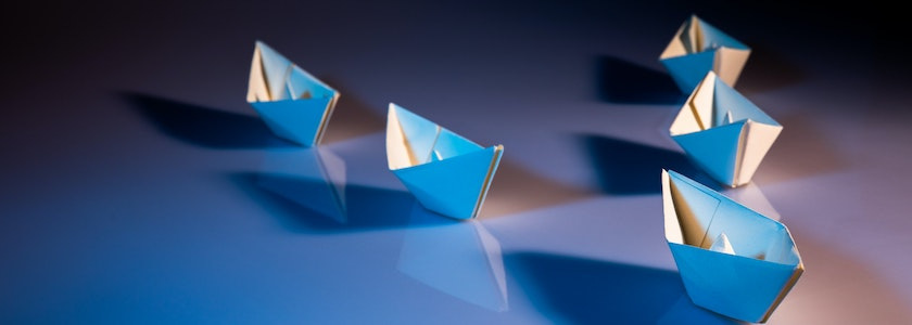 Marketing leadership concept with paper boats