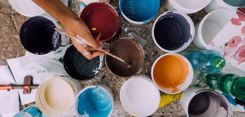 Group of multicolor paint buckets representing marketing creativity