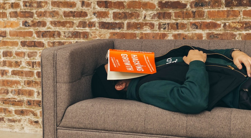 B2B marketing leader stressed about marketing challenges while reading book