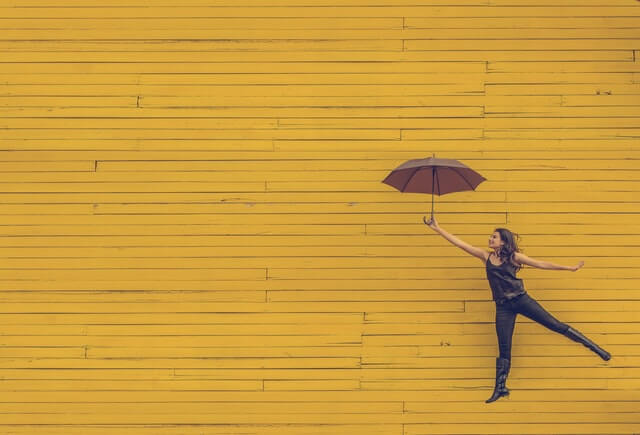 woman flying with umbrella