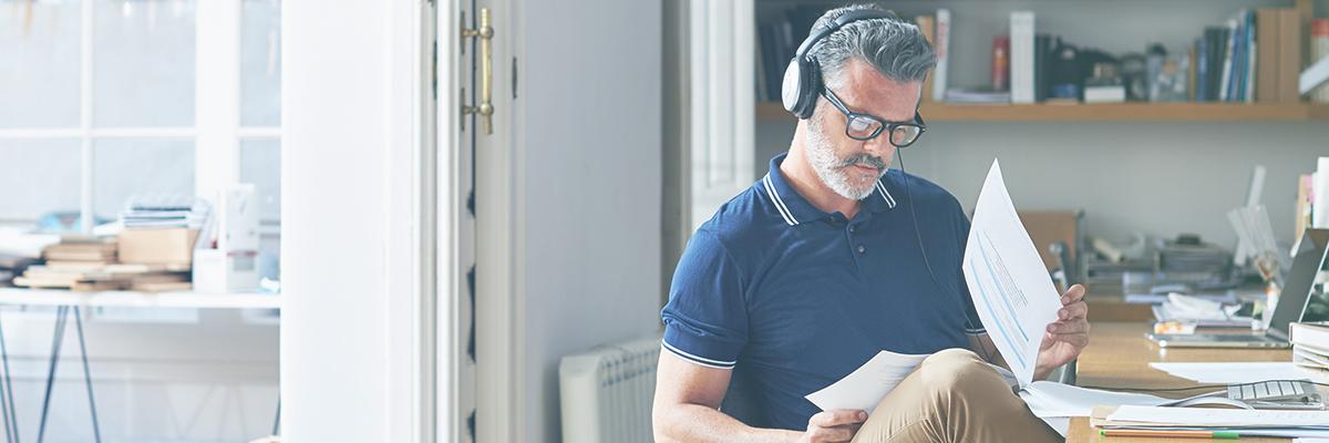 Man with headphones reading