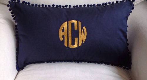 It's monogram Monday! Loving this pom pom pillow from...