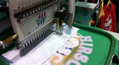 Seit Singlehead Embroidery Laser Is In Action at SGIA Orlando