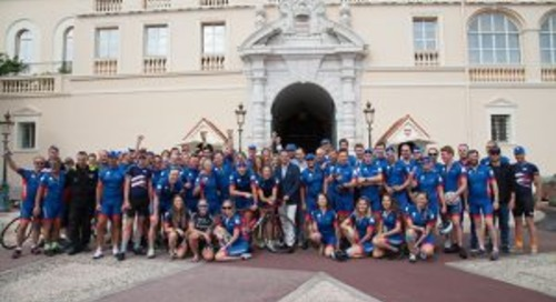 London to Monaco cyclists arrive at the Palace
