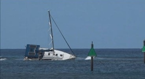 Boat tips on side after hitting reef
