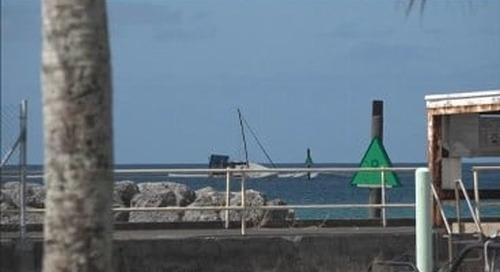 Boat that ran aground remains at Agat Marina