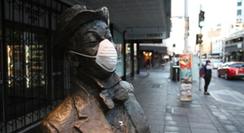 Adelaide statues don dusk masks for coal's dirty legacy