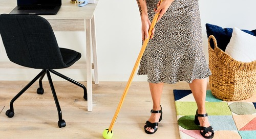 Stick a Tennis Ball on the End of Your Broom to Make a Super-Powered Floor Cleaning Tool