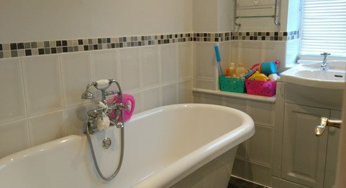 Before and After: This Plain Gray Bathroom Went Bright and Bold