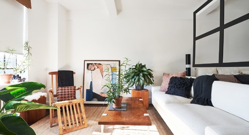 A 525-Square-Foot Studio Features Clever Room Dividing and Storage Ideas