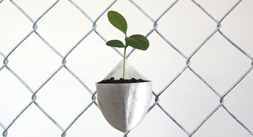 Turn Any Chain Link Fence into a Vertical Garden With This Simple Planter