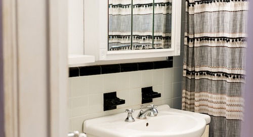 Before and After: See a Dark, Damp Bathroom's  Carrara Marble-Filled Transformation