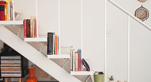 7 Smart Ways to Decorate the Dead Space Under Your Stairs