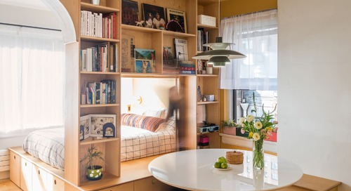 This Bookshelf Divider Brilliantly Makes a 450-Square Foot-Studio Feel Like a One Bedroom
