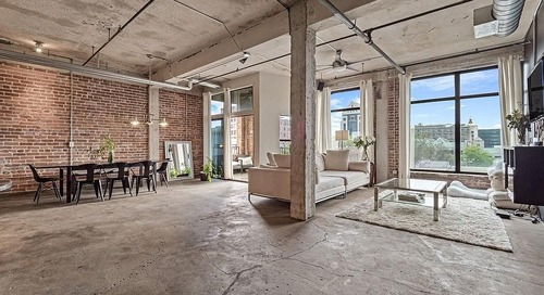 $245K buys this large, century-old loft space in the heart of downtown
