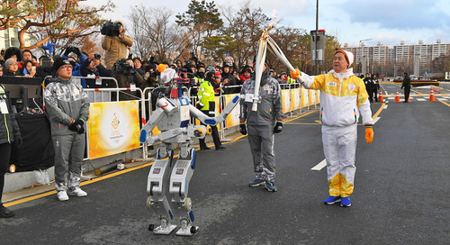 This robot is an Olympic torchbearer