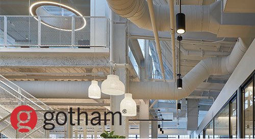 Minimalist lighting design celebrates architecture of industrial office space