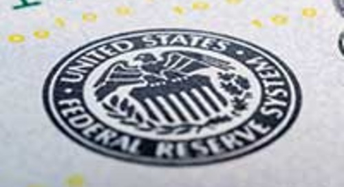 Divided Federal Open Market Committee cuts target rate
