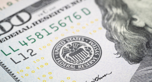 The Fed notes improving economy, higher inflation, but expects to hold rates until 2023