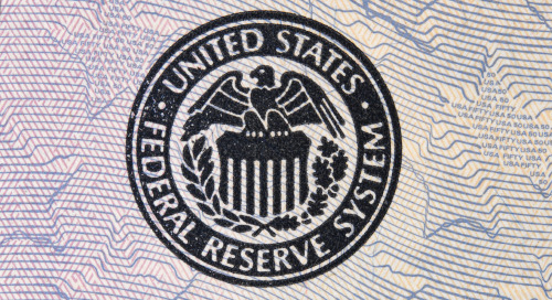 Fed stays put on rates but dot plots rise