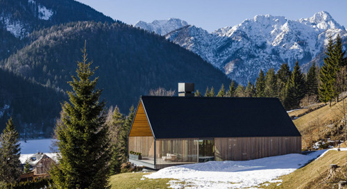 A Holiday Mountain Home Clad with Wood Sunshade in Tarvisio, Italy