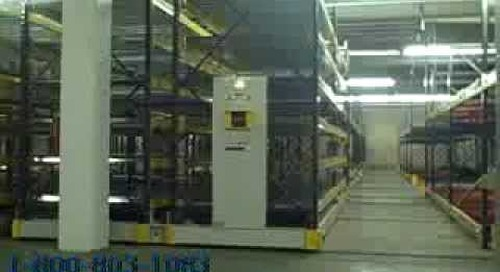 Synchronized Movable Aisle Pallet Racks Moving Between Building Columns