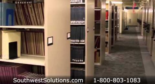 Library Shelving on Wheels Rolls on Tracks Turning Aisles into Storage Space