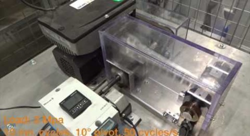 Plastic vs. PTFE bearing high speed belt tensioner pivot wear test