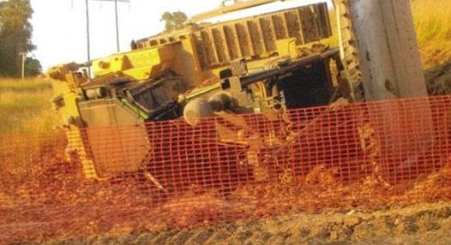 Dozer rolls on old bund | Warning on working on crossgrades