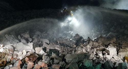 Dozer burns on blast heap and coal mine