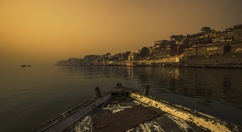 The best way to get up close and personal with India? On a boat down the Ganges